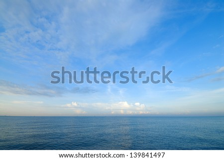 Horizon line between sky and sea water - stock photo