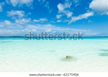 Horizon over clear blue tropical water of coral islands, Okinawa, Japan - stock photo
