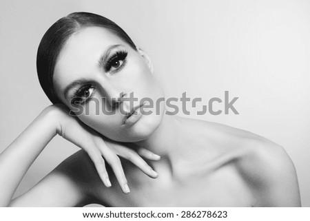 Horizontal black and white portrait of young beautiful woman with stylish false eyelashes - stock photo