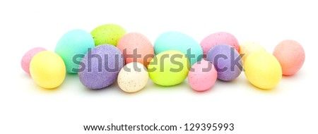 Horizontal border of colorful Easter eggs over white - stock photo