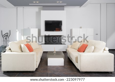 Horizontal composition of a modern and elegant living room in white - stock photo