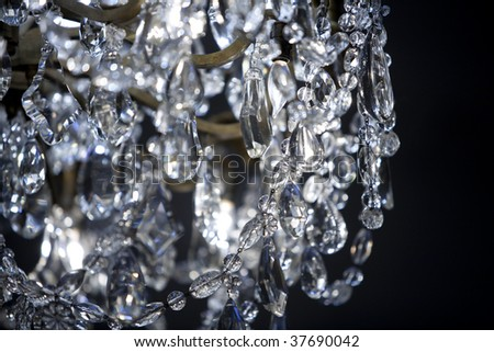 Horizontal detail image of a crystal chandelier. - stock photo