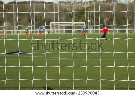 horizontal football match trough the net  - stock photo
