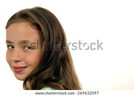 Horizontal Headshot Of Little Girl Looking Over Shoulder At Camera/ Little Girl Looking Over Shoulder At Camera Smiling - stock photo