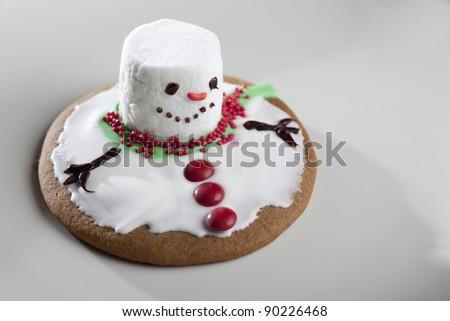 Horizontal image of a cookie, made to look like a melting snowman. - stock photo