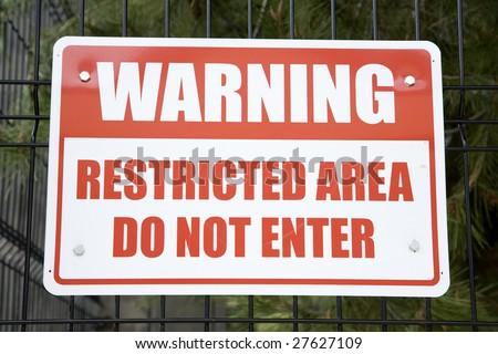 Horizontal image of a Warning sign, saying not to enter. - stock photo