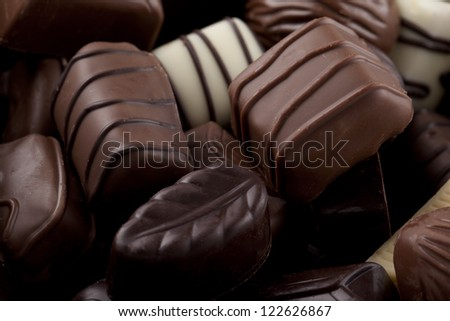 Horizontal image of assorted chocolates in different shapes and size - stock photo