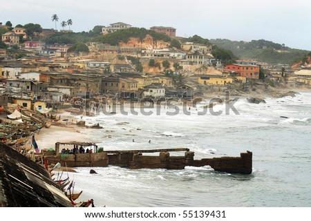 Horizontal of Cape Coast foreshore and houses - stock photo