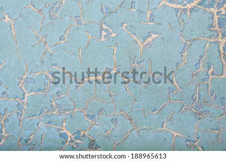 horizontal orientation close up of a vintage metal surface in porcelain blue color, with deep cracks throughout and copy space / Porcelain Blue Distressed Surface - stock photo
