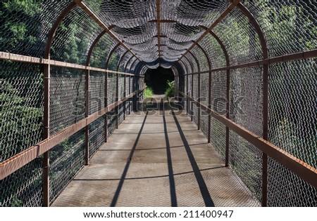 horizontal orientation of an enclosed, pedestrian, footbridge along the path to Kootenai River Falls in Montana, USA, with copy space / Kootenai River Falls Enclosed Bridge - Horizontal - stock photo