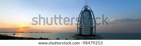 Horizontal panorama of of the famous Burj Al Arab Hotel at sunset. Dubai - stock photo
