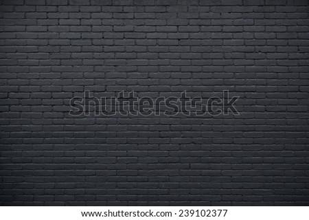 horizontal part of black painted brick wall - stock photo