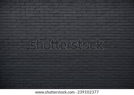 horizontal part of black painted brick wall - stock photo