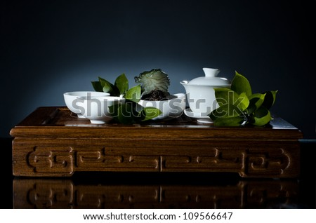 horizontal photo, still life of the china waret and   on dark blue  background - stock photo