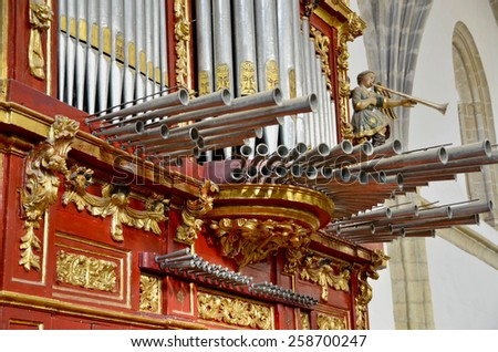 Horizontal pipes and tubes in an old organ - stock photo