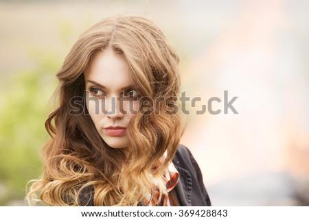 Horizontal portrait of a beautiful girl, outdoor close up shot - stock photo