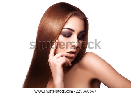 Horizontal portrait of sensual young adult girl with straight long perfect hair on white background in studio. isolated - stock photo