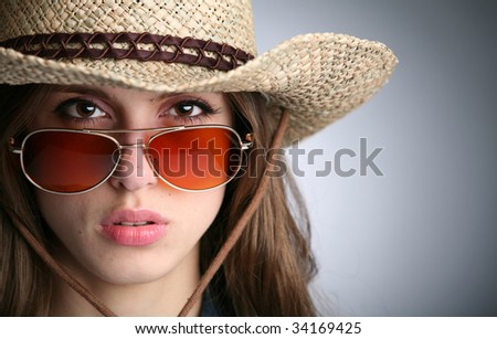 horizontal portrait of the girl in stetson and sunglasses - stock photo