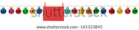 Horizontal seamless Christmas border with glass baubles on white background. Shallow DOF, focus on the envelope surface for easy insertion of text - stock photo