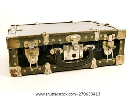 Horizontal shot of a vintage battered suitcase/ Old Vintage Suitcase - stock photo