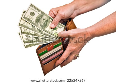 Horizontal Shot Of Hands Pulling Money Out Of Wallet/ Isolated On White/ The Hundred Dollar Bills Are Not Real - stock photo