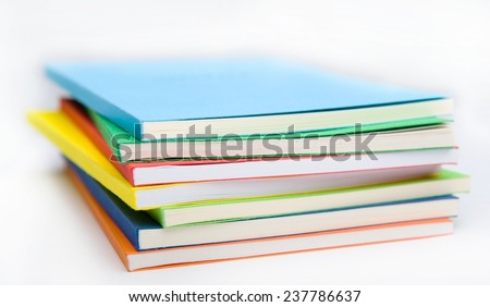Horizontal shot of isolated on the white background stack of vivid ledgers - stock photo