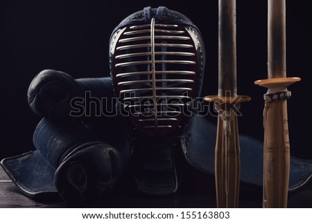 Horizontal shot of kendo equipment, black background - stock photo
