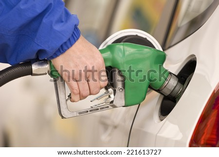 Horizontal Shot Of Pumping Gas/ Pumping Precious Gas Or Petrol - stock photo