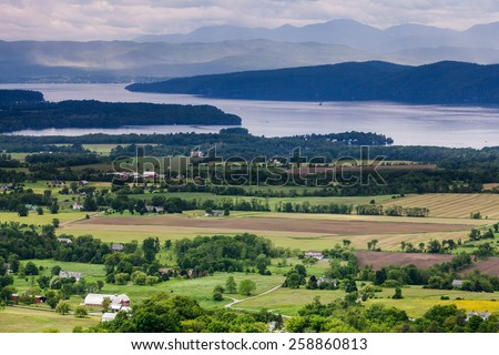 Horizontal Vermont Countryside scene looking towards Lake Champlain and the Adirondack Mountains.  The shot was taken from Mount Philo State Park - stock photo