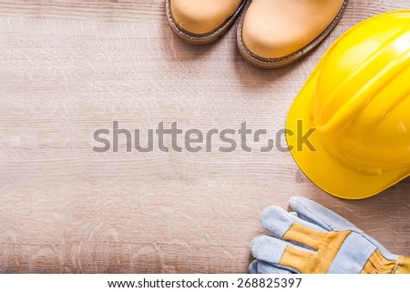 horizontal version organized copyspace working boots helmet gloves On Wooden Board  - stock photo