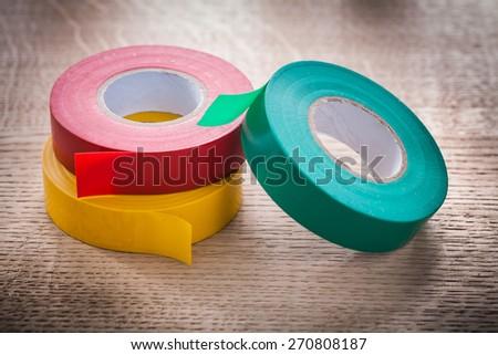 horizontal version three rolls of insulating tape construction concept  - stock photo