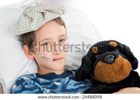 Horizontal view of a little boy home sick from school. - stock photo