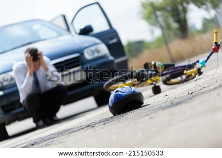 Horizontal view of a scared driver after accident - stock photo