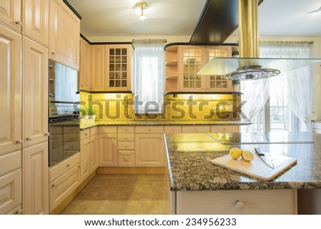 Horizontal view of beige furniture in  luxury kitchen - stock photo