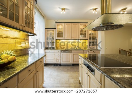 Horizontal view of big kitchen interior - stock photo