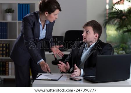 Horizontal view of boss yelling at employee - stock photo