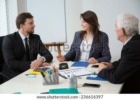Horizontal view of business conference in modern office - stock photo