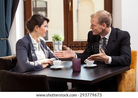 Horizontal view of business meeting in cafe - stock photo