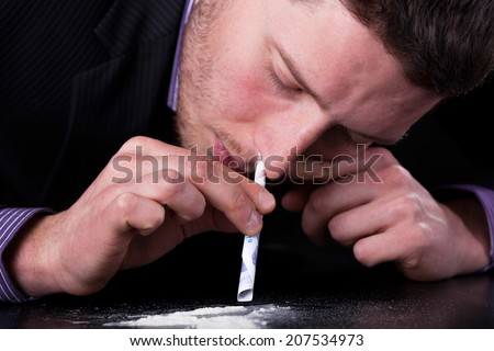 Horizontal view of businessman addicted to drugs - stock photo