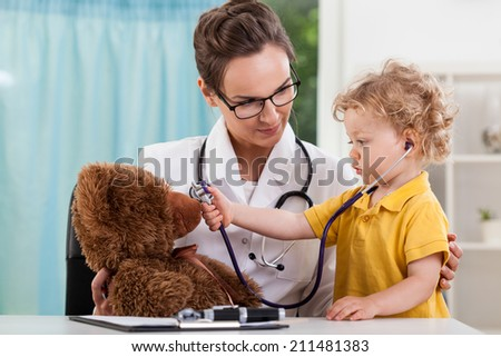 Horizontal view of child during medical appointment - stock photo