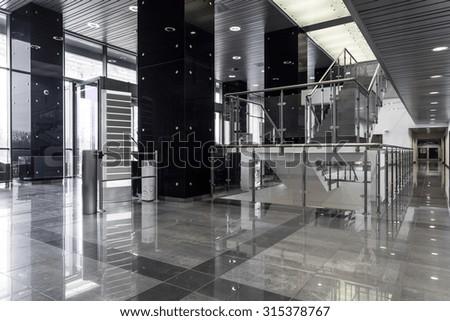Horizontal view of contemporary business building interior - stock photo