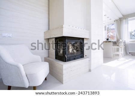 Horizontal view of fireplace in bright house - stock photo
