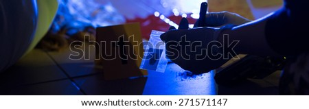 Horizontal view of forensic scientist at work - stock photo