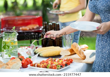 Horizontal view of friends during garden party - stock photo
