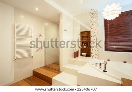 Horizontal view of interior of wooden bathroom - stock photo