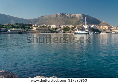 horizontal view of island sicily with yacht, see and beach - stock photo