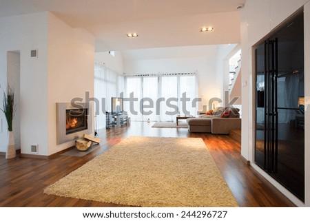 Horizontal view of luxury detached house interior - stock photo