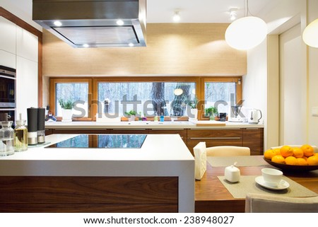 Horizontal view of luxury kitchen with modern equipment - stock photo