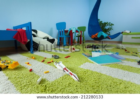 Horizontal view of mess in boy's room - stock photo