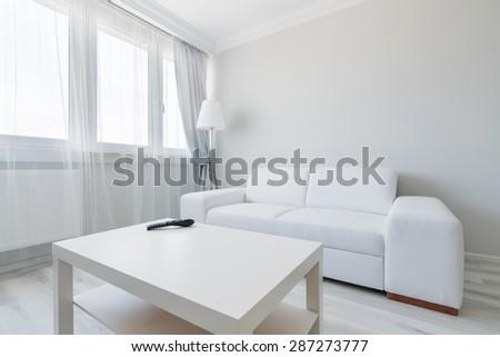 Horizontal view of minimalist living room design - stock photo